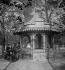 Waffle seller in the Tuileries Gardens. Paris (Ist arrondissement), circa 1895. Detail from a sterescopic view. © Léon et Lévy/Roger-Viollet