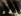 Quatre masques pris dans un jeu d'ombres et de lumières, 1933. © Giulio Parisio/Alinari/Roger-Viollet