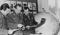 Pavel Popovich, Alexey Leonov and Yuri Gagarin, soviet cosmonauts, looking at the photos of the Moon taken by the Luna IX space probe in February 1966. © Roger-Viollet
