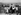 Tourists on the Eiffel Tower. Paris, April 1952. © Roger-Viollet