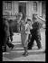 """Femme élégante au pesage, lors de la journée du Prix du Président de la République qui se déroule à l'hippodrome d'Auteuil. Paris (XVIe arr.), 9 avril 1939. Photographie du journal """"Excelsior"""". © Excelsior – L'Equipe/Roger-Viollet"""