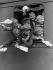 """Garçons saluant leurs familles lors d'un départ en vacances en train. Photographie publiée dans """"Tempo"""", 1929. © Ullstein Bild/Roger-Viollet"""