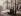 Né à Paris en 1813, Charles Marville commence sa carrière comme peintre-graveur ; il devient photographe vers 1850. Il collabore dès 1851 avec Blanquart-Evrard qui crée à Lille l'une des premières maisons d'édition de photographie. A l'instar des photographes de la Mission héliographique, Marville parcourt la France pour faire des prises de vue : architectures religieuses, album sur les bords du Rhin, etc. Spécialisé dans la reproduction d'œuvres d'art, il devient « photographe du musée impérial du Louvre ». En parallèle, il couvre les grands chantiers de restauration des architectes Viollet-le-Duc ou Abadie. En 1858, la Ville de Paris l'engage pour photographier le bois de Boulogne, alors ouvert au public. Afin de conserver un témoignage de l'aspect de l'ancienne capitale bouleversée par les grands travaux haussmanniens, le préfet crée le service des Travaux historiques qui charge Marville d'immortaliser ce patrimoine voué à disparaître. Entre 1865 et 1869 un ensemble de 425 clichés des rues de Paris sera ainsi produit. Le photographe documente par ailleurs certaines innovations haussmanniennes, comme le nouveau mobilier urbain ou les perspectives des voies nouvellement créées. Une grande partie de ces photographies est exposée au pavillon de la ville de Paris à l'Exposition universelle de 1878. Il meurt à Paris en 1879. Les collections municipales parisiennes, en particulier Musée Carnavalet, Bibliothèque Historique et Bibliothèque Administrative détiennent de nombreuses photographies de Charles Marville. © Charles Marville/Musée Carnavalet/Roger-Viollet