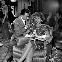 "Danielle Darrieux and Paul Meurisse during the shooting of ""Le Septième ciel"", film by Raymond Bernard. France, 1957. © Alain Adler / Roger-Viollet"