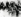 Guerre 1939-1945. Insurrection du ghetto de Varsovie. Général Stroop, un SS Allemand (derrière l'homme au centre) avec son état-major. A gauche : un couple juif capturé dans un sous-sol. Varsovie, 8 mai 1943. © Bilderwelt/Roger-Viollet