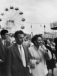 Fun fair on the Invalides esplanade. Paris, 1955. Photograph by Janine Niepce (1921-2007).  © Janine Niepce / Roger-Viollet