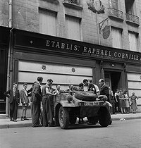 World War II. Liberation of Paris. Beginning of the Parisian insurrection. Kübelwagen vehicule taken from the Germans by the French Forces of the Interior. Paris (IInd arrondissement), 29 rue du Mail, August 20, 1944. Photograph by Jean Roubier (1896-1981). © Fonds Jean Roubier/Roger-Vio