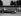 Stirling Moss (né en 1929) et Felice Bonetto (1903-1953), pilotes automobiles, lors du Grand Prix d'Italie à Monza, 13 septembre 1953. © TopFoto/Roger-Viollet