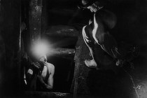Miners in the mine of Merlebach. Freyming-Merlebach (France), 1958. Photograph by Jean Marquis (1926-2019). © Jean Marquis / Roger-Viollet