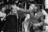 """Guy Lux (1919-2003), animateur de radio et télévision animant son émission """"Ring Parade"""" avec Rika Zaraï, chanteuse israëlienne. Vers 1975. © Jacques Cuinières / Roger-Viollet"""