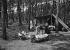 Jeune femme en camping repassant son linge devant sa tente. Les Sables-d'Olonne (Vendée), 1937.      © Roger-Viollet