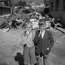 Young boys in the ruins of West Berlin. Germany, after 1945. © Gaston Paris / Roger-Viollet