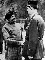 World War II. French General de Gaulle greeted by British Marshal Bernard Montgomery at his arrival in Normandy, after the Normany landings. June, 1944. © Roger-Viollet