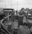 Life aboard a barge : deck cleaning. France, circa 1935. © Gaston Paris / Roger-Viollet