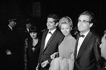 "17th Cannes Film Festival. Agnès Varda and Jacques Demy, French directors, Michel Legrand, French composer, and Christine Bouchard, his first wife, after winning the ""Palme d'Or"" for ""Les Parapluies de Cherbourg"". Cannes, May 1964. © Noa / Roger-Viollet"