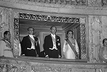 Mohammad Reza Pahlavi (1919-1980), Shah of Iran, Valéry Giscard d'Estaing (born in 1926), President of the French Republic, and Farah Dibah (born in 1938), Empress consort of Iran, attending an event at the Palace of Versailles (France). © Jacques Cuinières / Roger-Viollet