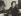 Marguerite Duras (1914-1996), écrivain français, chez elle. Paris, 1955. © Boris Lipnitzki / Roger-Viollet