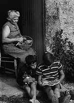 Boys spending their summer holidays at the farm with their grandmother. 1963. Photograph by Janine Niepce (1921-2007). © Janine Niepce / Roger-Viollet