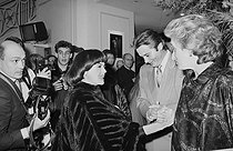 """Mireille Mathieu, Alain Delon and Bernadette Chirac, attending the premiere of """"Kean"""" at the Théâtre Marigny. Paris, February 1987. © Carlos Gayoso / Roger-Viollet"""