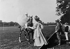 Polo à Bagatelle, bois de Boulogne. Le jeu de l'ombrelle. Paris (XVIème arr.), 1908. © Maurice-Louis Branger/Roger-Viollet