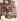 """Marchande de fruits de mer devant le cabaret """"Au Port Salut"""", rue des Fossés Saint-Jacques. Paris (Vème arrondissement), 1903. Photographie d'Eugène Atget (1857-1927). Paris, musée Carnavalet. © Eugène Atget / Musée Carnavalet / Roger-Viollet"""