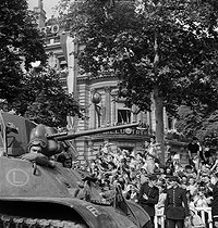 World War II. Liberation of Paris. Parade of tanks from the 2nd Armored Division commanded by General Leclerc. The Langlade Tactical Group on the Champs-Elysées. Paris (VIIIth arrondissement), on August 26, 1944. Photograph by Jean Roubier (1896-1981). © Fonds Jean Roubier/Roger-Vio