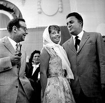1960 Cannes Film Festival.  Georges Simenon (1903-1989), foreman of the jury, Giulietta Masina (1920-1994) and Federico Fellini (1920-1993). © Roger-Viollet