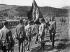 Guerre d'Espagne (1936-1939). Soldats du 60ème régiment d'infanterie prêtant allégeance devant le drapeau de la Légion en défilant devant Francisco Franco (1892-1975) et José Millán-Astray (1879-1954), généraux espagnols. © Iberfoto / Roger-Viollet
