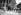 Chargement de paniers aux Halles centrales, devant l'église Saint-Eustache. Paris, vers 1900. © Jacques Boyer/Roger-Viollet