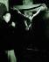 """Salvador Dali (1904-1989), peintre et graveur espagnol devant une de ses toiles """"Le Christ crucifié"""", 1954. © Iberfoto / Roger-Viollet"""