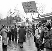 """Long live the Republican and secular school"", sign during an antifascist rally. Paris, on February 10, 1946. Photograph by Roger Berson. © Roger Berson/Roger-Viollet"