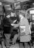 Sale of a painting in a café in Montparnasse. Paris, about 1930.  © Albert Harlingue / Roger-Viollet