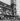Voyageurs devant la gare de Lyon. Paris (XIIème arr.), 1956. Photographie de Janine Niepce (1921-2007). © Janine Niepce/Roger-Viollet
