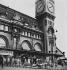 Travellers in front of the Gare de Lyon station. Paris (XIIth arrondissement), 1956. Photograph by Janine Niepce (1921-2007). © Janine Niepce/Roger-Viollet