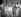 """Fidel Castro (1926-2016), homme d'Etat et révolutionnaire cubain, lisant """"El Imparcial"""" au milieu d'étudiants, de journalistes et de révolutionnaires. La Havane (Cuba), janvier 1959. © Saavedra / The Image Works / Roger-Viollet"""