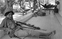 Cambodian War. Young Cambodian soldier near the front line where is settled the Khmer Rouge army. Cambodia, 1973. © Françoise Demulder / Roger-Viollet