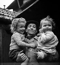Miners. The miner and his children. Waziers (France). Aniche mines company, 1931. Photograph by François Kollar (1904-1979). Paris, Bibliothèque Forney. © François Kollar/Bibliothèque Forney/Roger-Viollet