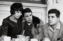 "Bernadette Lafont, Gérard Blain and Jean-Claude Brialy, French actors, at the café ""Les Deux-Magots"". Paris, April 1959. © Bernard Lipnitzki / Roger-Viollet"