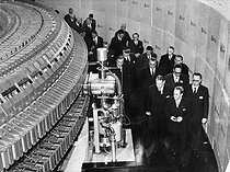 "The president René Coty inaugurating the cyclotron ""Saturne"" with the physicist Francis Perrin (1901-1992). Saclay, November 6, 1958. © Roger-Viollet"
