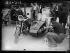 """Suite à la signature du pacte germano-soviétique du 23 août 1939, un réserviste mobilisé peint le côté de sa moto en indiquant le numéro du corps militaire auquel il appartient. Août 1939. Photographie du journal """"Excelsior"""". © Excelsior – L'Equipe/Roger-Viollet"""