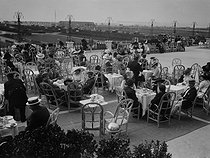 Teatime at the terrace of the casino of Deauville (France), 1912. © Maurice-Louis Branger / Roger-Viollet