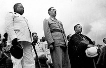 Conference of Brazzaville (Congo). January, 1944. General De Gaulle singing the Marseillaise at the inauguration of Félix-Eboué stadium. On the left : Félix Eboué, general governor of the A.E.F. January, 1944. © Roger-Viollet