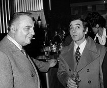 """Charles Aznavour (1924-2018), Armenian-born French singer-songwriter and actor, and Bruno Coquatrix (1910-1979), French music hall manager, at the """"Cintra"""". Paris, on February 16, 1972. © Patrick Ullmann / Roger-Viollet"""