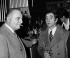"""Charles Aznavour (1924-2018), auteur-compositeur-interprète et acteur français d'origine arménienne, et Bruno Coquatrix (1910-1979), directeur de salles de spectacles français, au """"Cintra"""". Paris, 16 février 1972. © Patrick Ullmann / Roger-Viollet"""