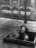 "Photographe de presse au travail. Photographie de B. Federmeyer publiée dans ""Vlatt"", 1929. © B. Federmeyer/Ullstein Bild/Roger-Viollet"
