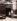 """""""Au Réveil Matin, 135 rue Amelot"""", Paris (XIème arr.). Photographie d'Eugène Atget (1857-1927). Paris, musée Carnavalet. © Eugène Atget / Musée Carnavalet / Roger-Viollet"""