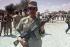War Iran-Iraq. Ahvaz front. Iranian soldier guarding Iraqi prisoners. Iran, April 1982. $$$ © Françoise Demulder / Roger-Viollet