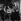 """Jean-Pierre Mocky (1929-2019), acteur et réalisateur français, avec Stefania Sandrelli et Charles Belmont, lors du tournage de son film """"Les Vierges"""". France, 1962. © Alain Adler / Roger-Viollet"""