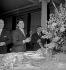Ray Ventura, Sacha Distel et Bruno Coquatrix au baptême de Carole Ventura. Paris, mai 1954.  © Roger Berson / Roger-Viollet