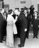"""Lord Louis Mountbatten, amiral britannique, faisant un baisemain à la reine Elisabeth II à l'arrivée de celle-ci au musée impérial de la guerre ; à l'occasion du feuilleton """"The Life and Times of Lord Mountbatten"""". A gauche : le prince Philip. 19 décembre 1968. © TopFoto / Roger-Viollet"""